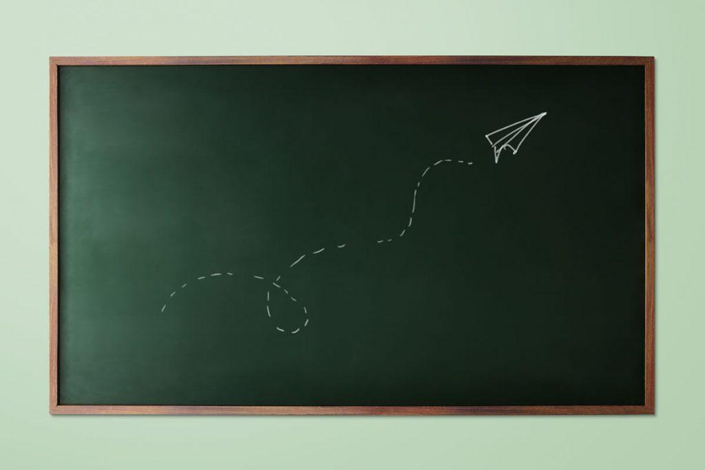 blackboard drawing paper plane